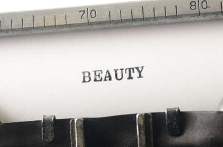 prettiness: word beauty typed on old typewriter Stock Photo