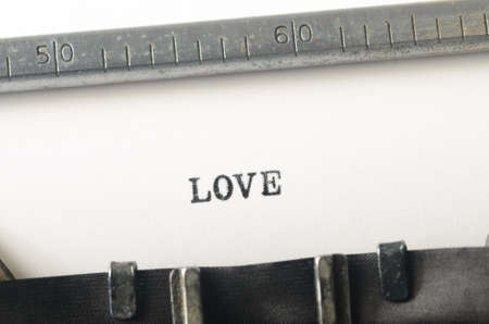 typed: word love typed on old typewriter