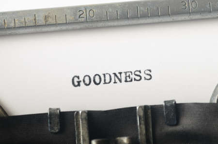 goodness: word goodness typed on old typewriter