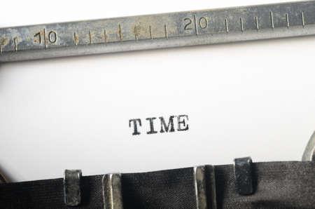 written communication: word time typed on old typewriter Stock Photo