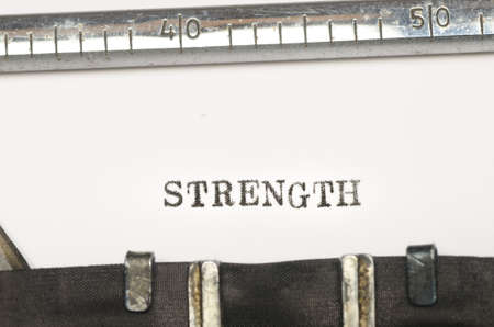 strenght: word strenght typed on old typewriter Stock Photo