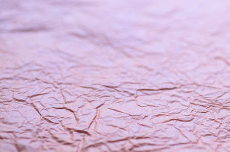 creased: violet creased paper background texture selective focus