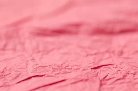 creased: red creased paper background texture selective focus Stock Photo