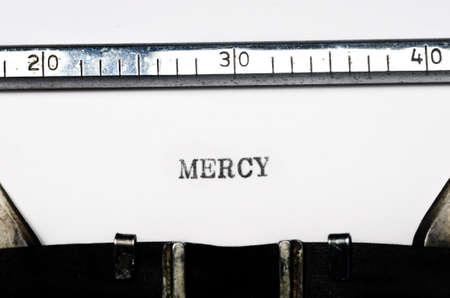 word mercy typed on  old typewriter Stock Photo