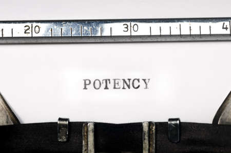 potency: word potency typed on  old typewriter