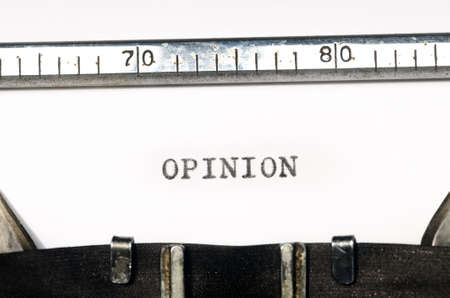 opinion: word opinion typed on  old typewriter