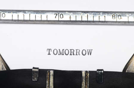 Word tomorrow typed on an old typewriter