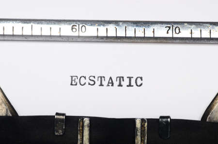ecstatic: Word ecstatic typed on an old typewriter