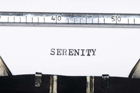 typed: Word serenity  typed on an old typewriter