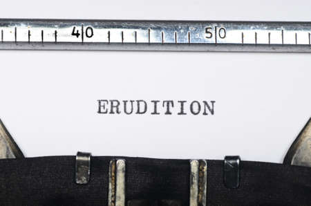 erudition: Word erudition typed on an old typewriter