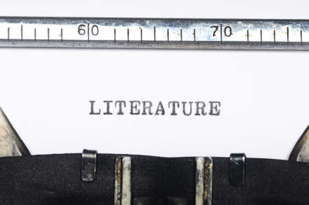 typed: Word literature typed on an old typewriter