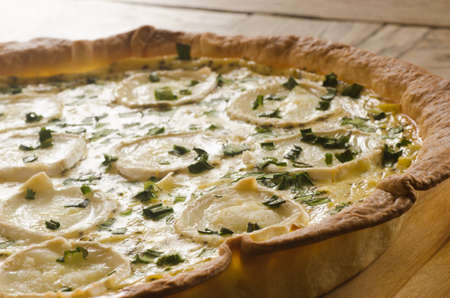 closeup to  tart with goat cheese