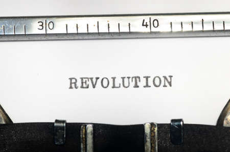 insurrection: word revolution typed on an old typewriter
