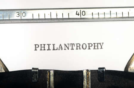 typed: word philantropy typed on an old typewriter