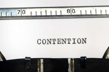 assertion: word contention typed on an old typewriter Stock Photo