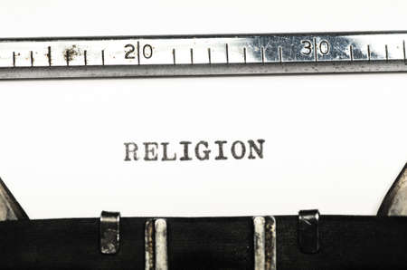 typed: word religion typed on an old typewriter