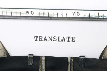 transcribe: word translate typed on an old typewriter Stock Photo