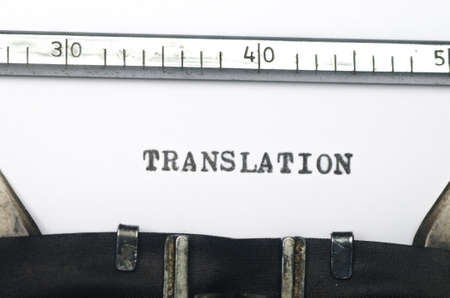 transposition: word translation typed on an old typewriter