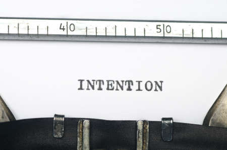 intention: word intention typed on an old typewriter