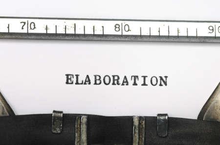 elaboration: word elaboration typed on an old typewriter