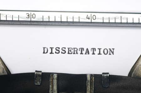 dissertation: word dissertation typed on an old typewriter