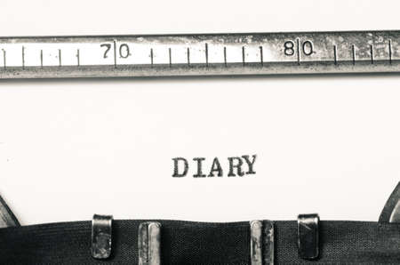 typed: word diary typed on an old typewriter