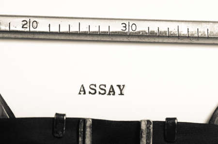 assay: word assay typed on an old typewriter