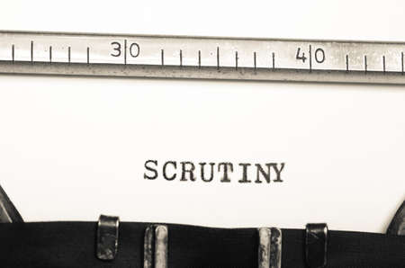 scrutiny: word scrutiny typed on an old typewriter Stock Photo