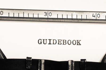 guidebook: word guidebook typed on an old typewriter