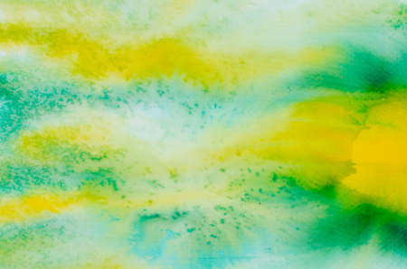 artisitc: green and yellow watercolor painted on paper backround texture