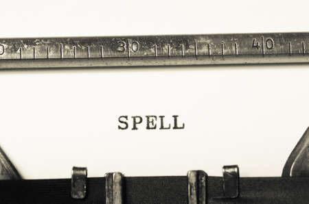 orthography: Word spell typed on an old typewriter