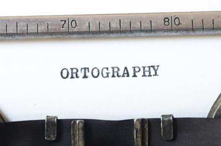 orthography: word ortography  typed on old typewriter