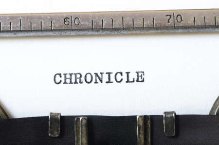 chronicle: word chronicle typed on old typewriter Stock Photo