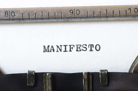 word manifestotyped on old typewriter