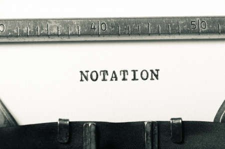 notation: word notation typed on old typewriter