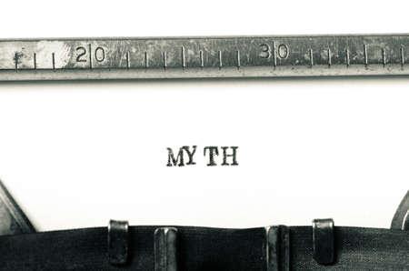 typed: word myth typed on old typewriter