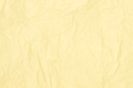 crumpled tissue: crumpled yellow paper tissue  backgground texture Stock Photo
