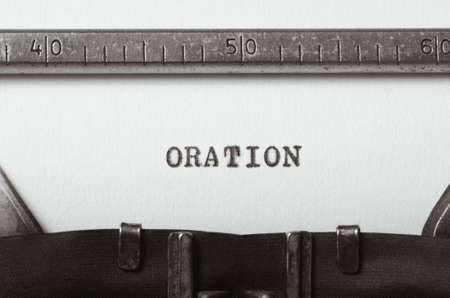 parlance: word oration typed on old typewriter