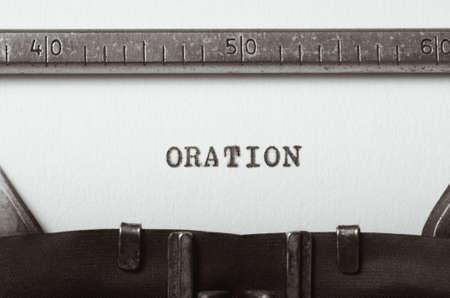 oration: word oration typed on old typewriter