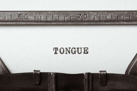parlance: word tongue typed on old typewriter Stock Photo