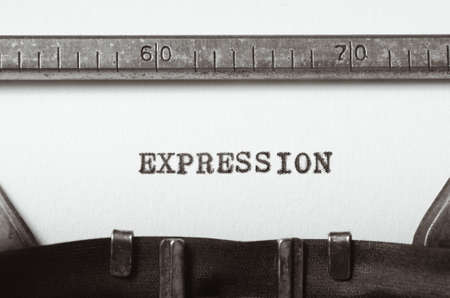 typed: word expression typed on old typewriter Stock Photo
