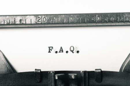 typed: word faq typed on old typewriter