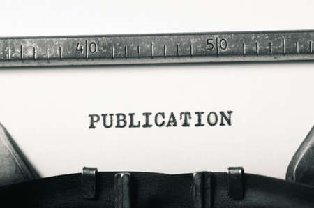 typed: word publication typed on old typewriter