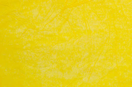 tissue paper: creased yellow tissue paper background texture