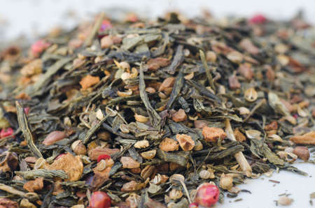 theine: closeup to dried tea leaves and fruits