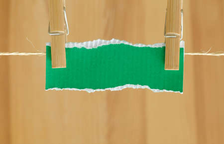 peg: blank piece of paper and clothes peg Stock Photo