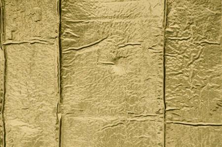 metalized: golden creased metallic paper background texture