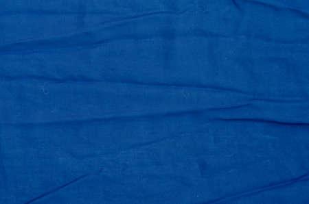 creased: creased dark blue textile background texture