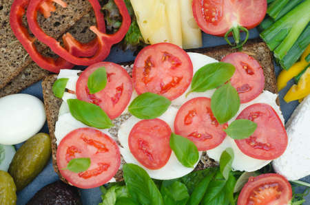 sanwich: healthy sandwich with mozzarella, tomato and basil on table
