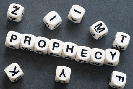 portent: word prophecy on white toy cubes